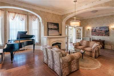 ... into the living room complete with grand piano