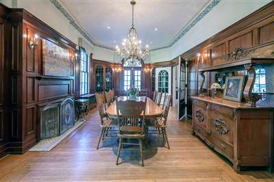 formal dining room with wood panelling